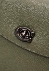 Coach - POLISHED PEBBLED CASSIE CROSSBODY - Handbag - light fern - 4