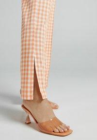 Bershka - Trousers - orange - 3