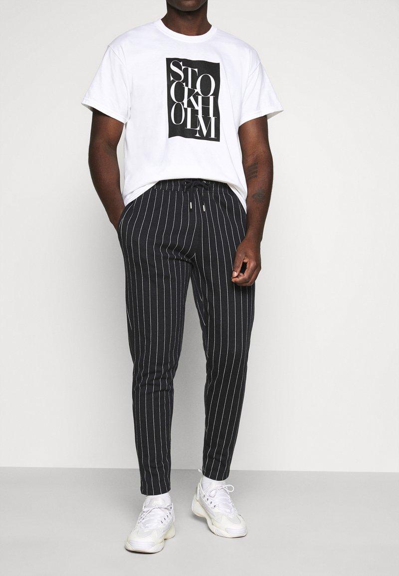 Topman - STRIPE JOG - Tracksuit bottoms - black