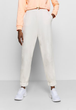 HIGH WAIST OVERSIZED - Tracksuit bottoms - beige