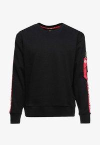 TAPEEXCLU - Sweatshirt - black