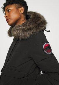 Superdry - EVEREST - Winter jacket - black - 7