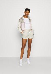 Nike Sportswear - Shorts - coconut milk/black - 1