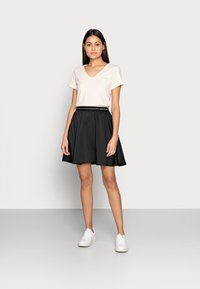 Calvin Klein Jeans - LOGO ELASTIC SKIRT - Mini skirt - black - 1