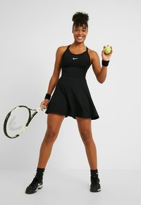 Nike Performance - DRY DRESS - Sports dress - black/white - 1