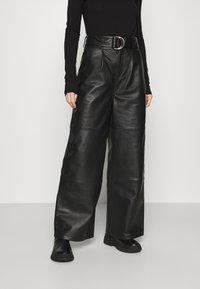 Deadwood - POPPY PANTS - Leather trousers - black - 0