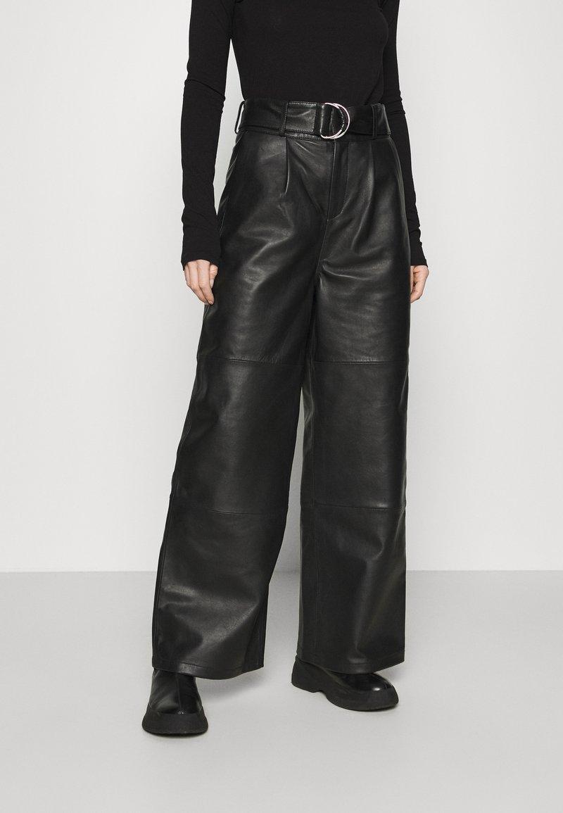 Deadwood - POPPY PANTS - Leather trousers - black