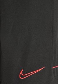 Nike Performance - SHORT - Sports shorts - black/siren red - 4