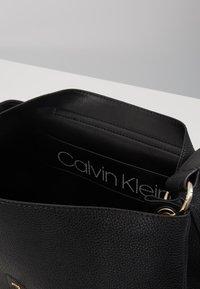 Calvin Klein - LOCK TOP HANDLE SATCHEL - Handbag - black - 4