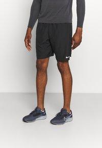 Nike Performance - CHALLENGER SHORT - Sports shorts - black - 0