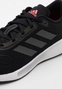 adidas Performance - GALAXAR RUN - Neutral running shoes - core black/grey five/signal pink - 5