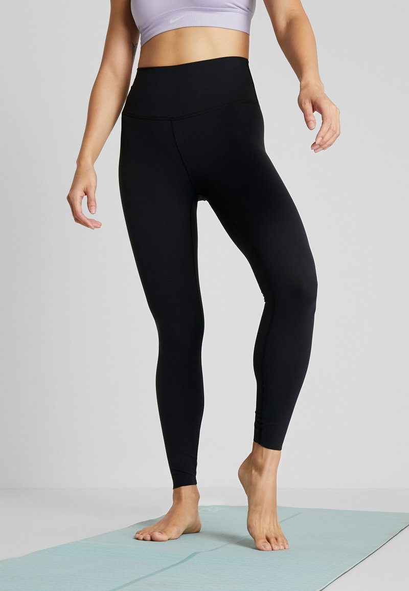 Nike Performance - THE YOGA LUXE - Tights - black/dark smoke grey