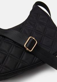 Lindex - BAG BAGUETTE QUILTED - Handbag - black - 3