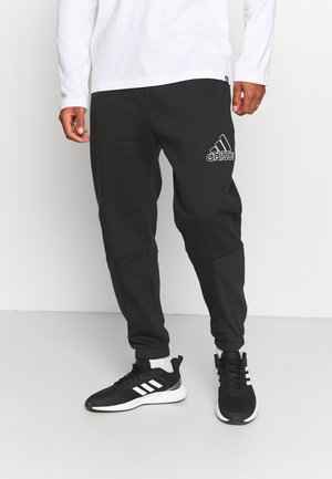 ESSENTIALS RELAXED - Spodnie treningowe - black