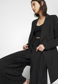 Monki - SEVERINA TROUSERS - Trousers - black dark - 3