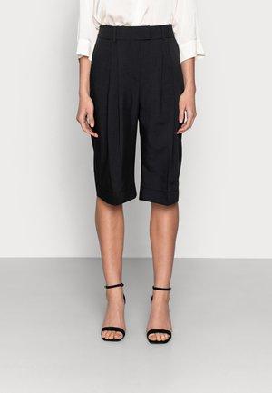 PRINCE PANTS - Shorts - black
