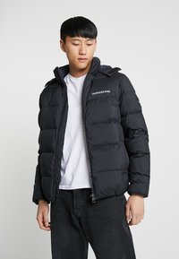 Calvin Klein Jeans - HOODED DOWN PUFFER  - Winter jacket - black - 0