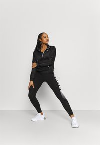Puma - TRAIN LOGO QUARTER  - Training jacket - puma black - 1