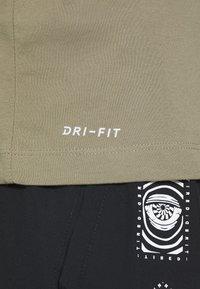 Nike Performance - TEE CREW SOLID - Basic T-shirt - light army/black - 5