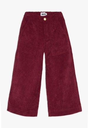 ALYNA - Trousers - sumak