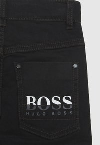 BOSS Kidswear - TROUSERS - Džíny Slim Fit - black - 2