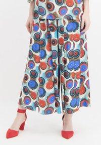 Nicowa - MIT GESCHLITZEM BEIN - Trousers - blue - 0