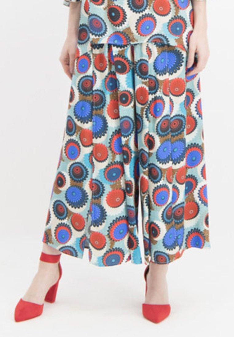 Nicowa - MIT GESCHLITZEM BEIN - Trousers - blue