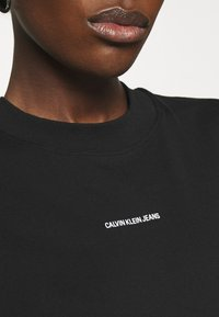 Calvin Klein Jeans - MICRO BRANDING DRESS - Jersey dress - black - 4