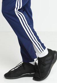 adidas Performance - TIRO 19 - Tracksuit bottoms - darkblue/white - 3