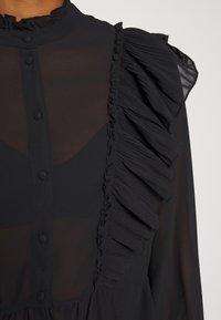 Vero Moda - VMIRIS FRILL  - Button-down blouse - black - 7
