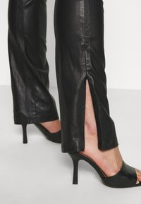 Ibana - LUCILLE - Leather trousers - black - 4