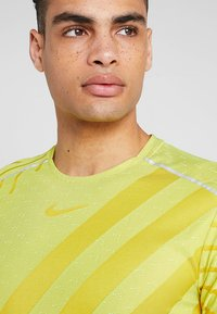 Nike Performance - TECH COOL  - Print T-shirt - volt/dark sulfur/reflective silver - 3