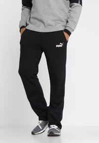 Puma - ESS LOGO PANTS  - Tracksuit bottoms - puma black - 0