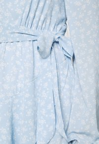 NA-KD - PAMELA REIF X ZALANDO OVERLAPPED FRILL MINI DRESS - Day dress - dusty blue - 4