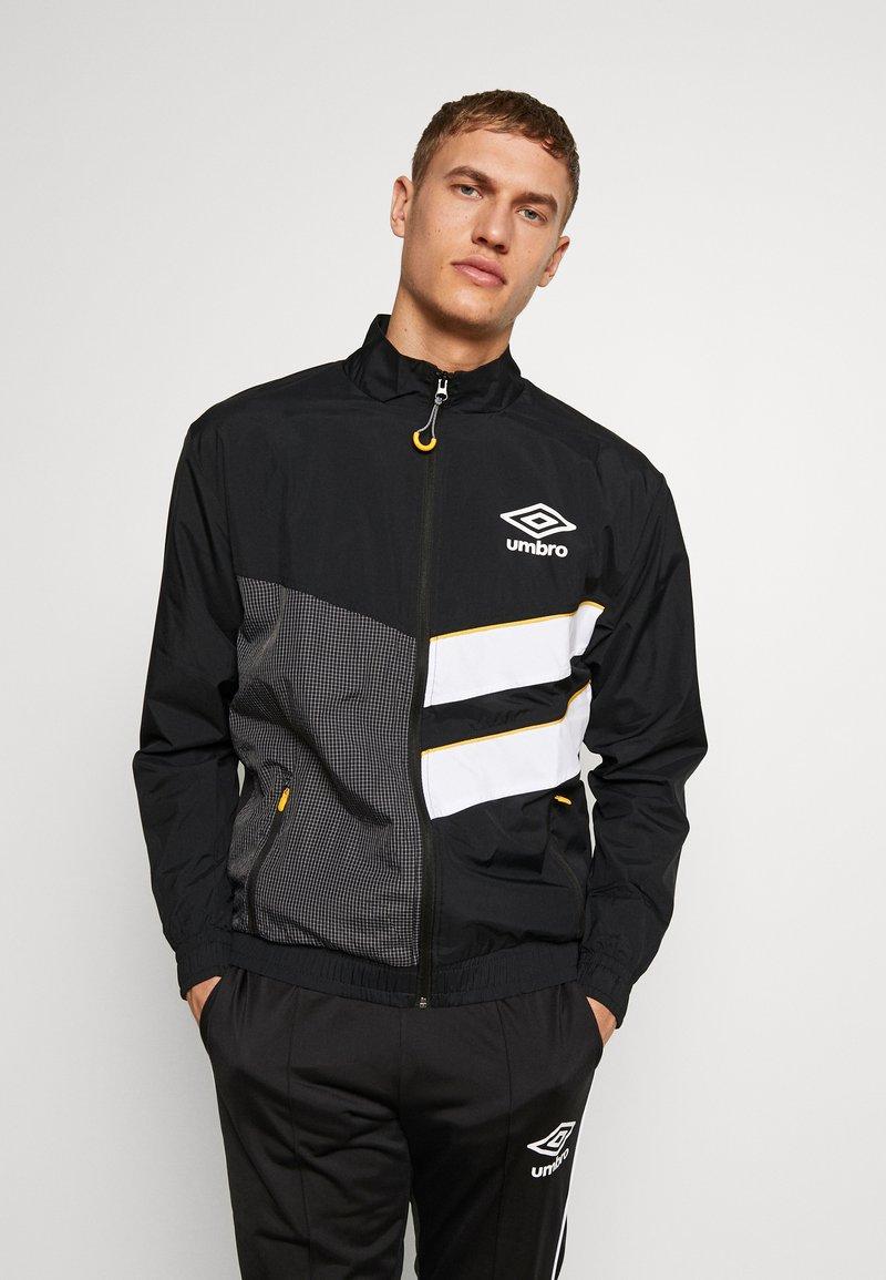 Umbro - DIAMOND CUT TRACK JACKET - Training jacket - black/brilliant white