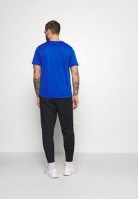 Nike Performance - SHIELD - Tracksuit bottoms - black/reflective silver - 2