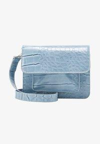 CAYMAN MINI - Across body bag - dusty blue