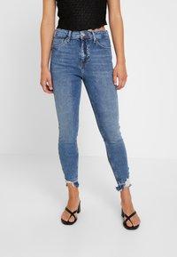 Topshop Petite - RIP HEM JAMIE - Jeans Skinny Fit - blue denim - 0