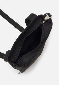 Calvin Klein Jeans - PRIDE MICRO FLAT PACK UNISEX - Across body bag - black - 2