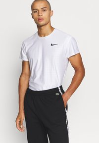 Lacoste Sport - PANT TAPERED - Tracksuit bottoms - black - 3