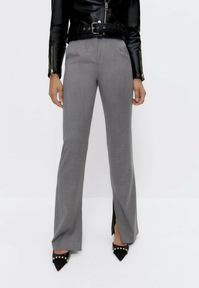 Uterqüe - Trousers - grey