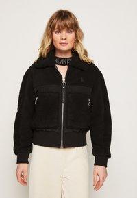 Calvin Klein Jeans - POLAR SHORT JACKET - Winter jacket - black - 0