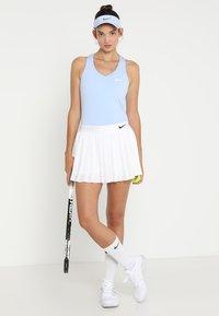 Nike Performance - VICTORY SKIRT - Sports skirt - white/black - 1