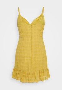 Missguided - TEXTURED WRAP FRILL MINI DRESS - Kjole - mustard - 1