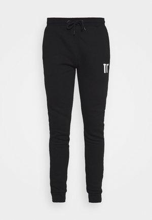 CORE SKINNY FIT - Teplákové kalhoty - black