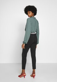 Aaiko - TABITA  - Trousers - black - 2