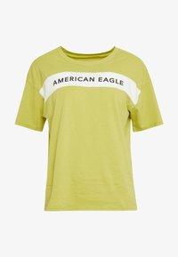American Eagle - BRANDED SEAMED SANTA MONICA TEE - Print T-shirt - yellow - 4