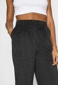 NA-KD - NARROW HEM TROUSERS - Trousers - black - 5