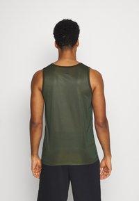 Nike Performance - Sports shirt - olive - 2
