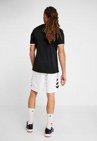 Hummel - CORE SHORTS - Sports shorts - white - 2